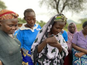 A group of women learn about Solvatten's use and impact on health, hygiene and environment during a demonstration